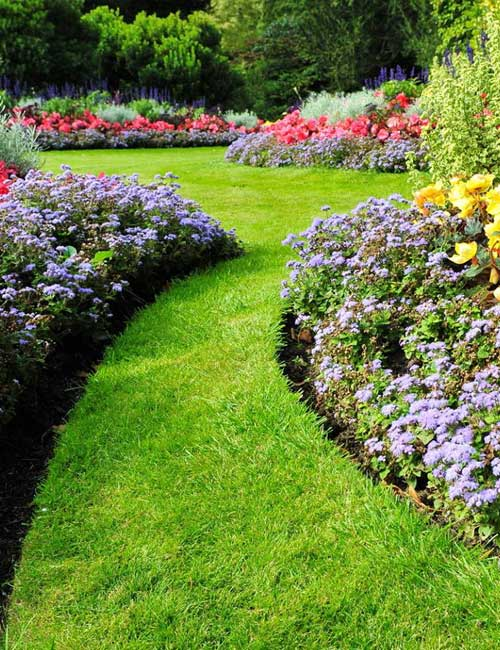Beautifully landscaped flower beds and and lawn maintained by Create-A-Scape in New Jersey