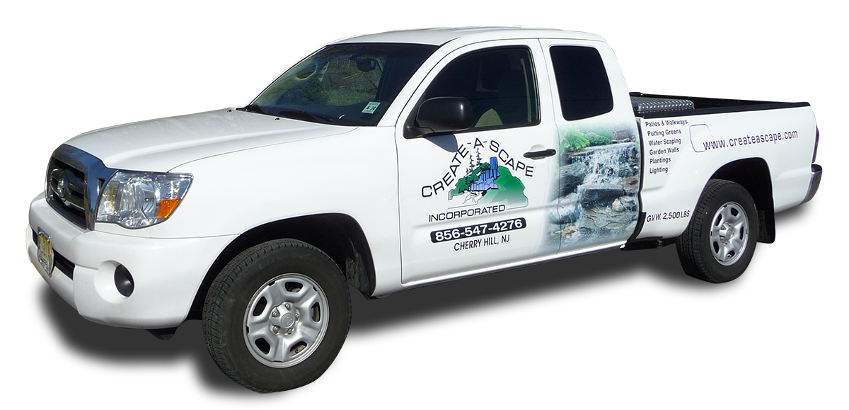 Create-A-Scapes truck with logo maintaining lawns in New Jersey