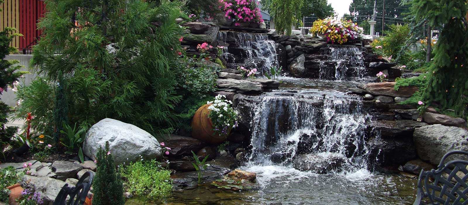 Hardscape waterfall feature in a well maintained yard in Cherry Hill New Jersey